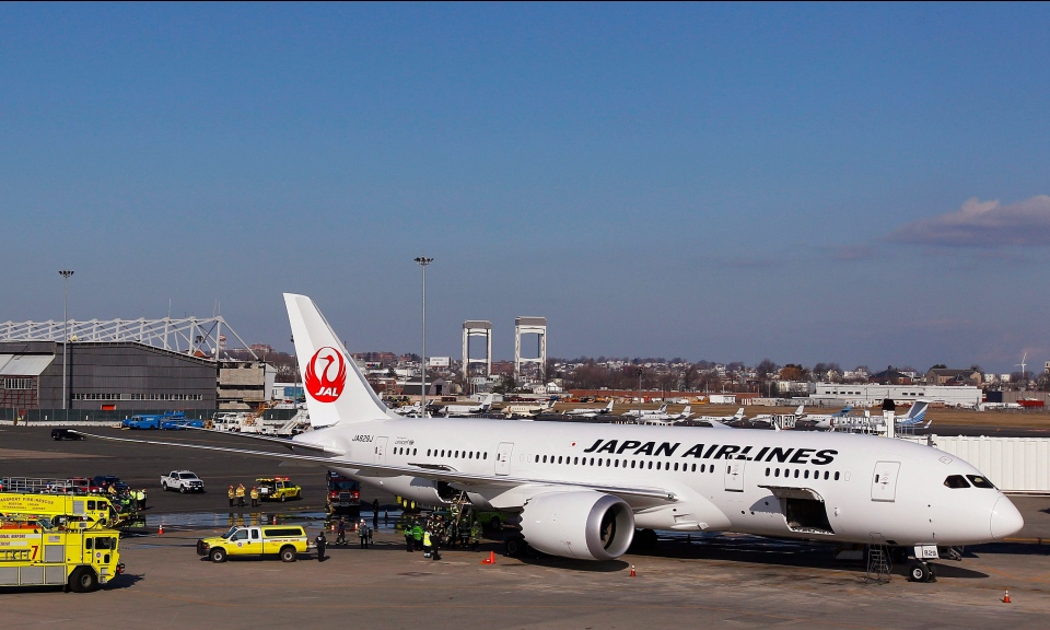 A Japan Airlines Boeing 787 Dreamliner jet aircraft is surrounded by emergency vehicles while parked at a terminal E gate at Logan International Airport in Boston, Monday, Jan. 7, 2013. (AP / Stephan Savoia)