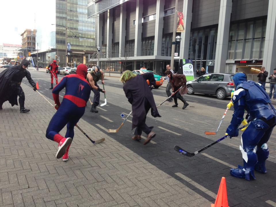 People in costume play hockey outside in Toronto on Saturday, Jan. 12, 2013.