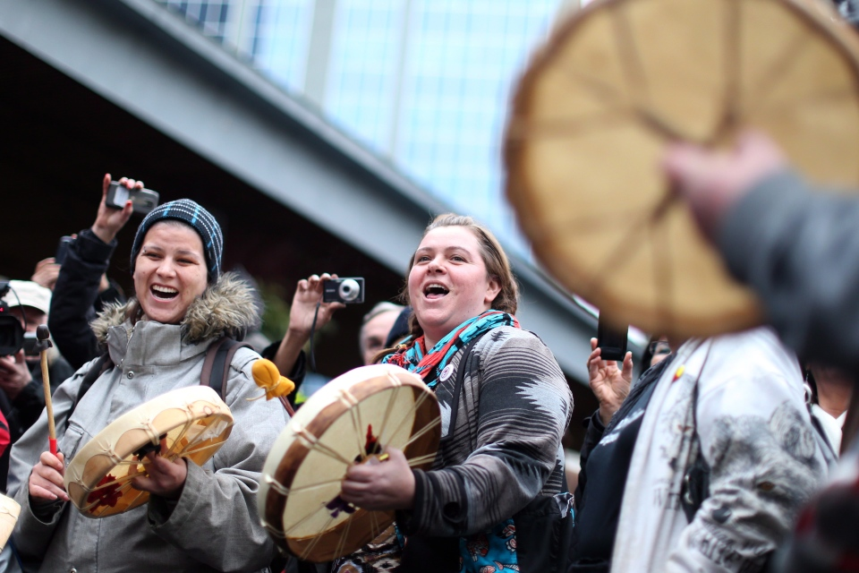 Idle No More form a drum circle as supporters gather in Toronto's Dundas Square on Friday January 11, 2013 as the aboriginal movement gathers momentum. (Chris Young / THE CANADIAN PRESS)