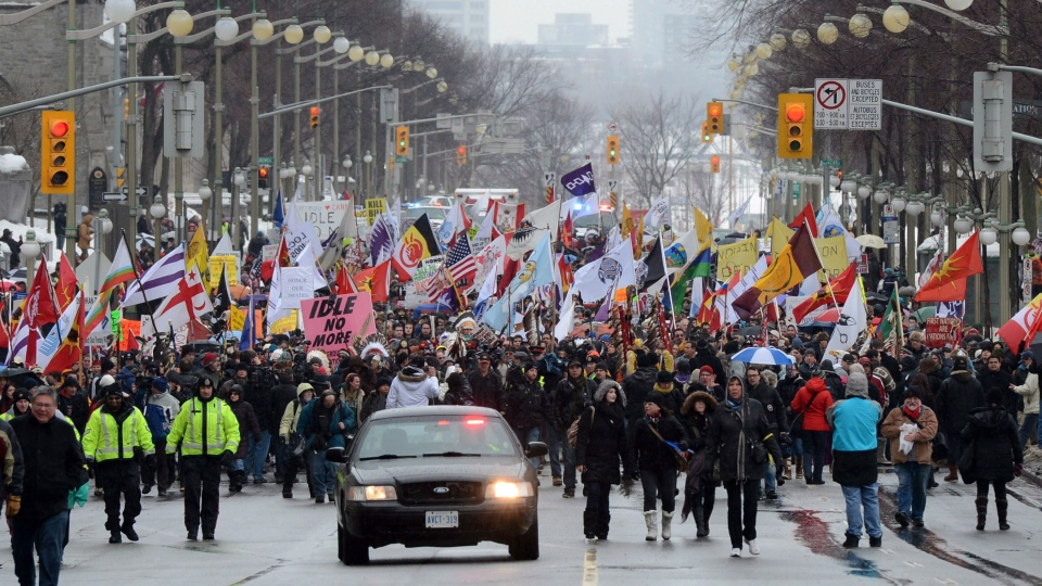 Native protesters march up Wellington Street in Ottawa on Friday, Jan. 11, 2013. (Sean Kilpatrick / THE CANADIAN PRESS)