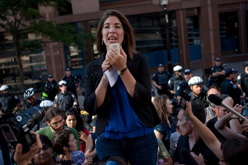 Writer Naomi Klein addresses the crowd as hundreds of demonstrators gather outside Toronto Police Headquarters in this June 2010 file photo. (Chris Young / THE CANADIAN PRESS)