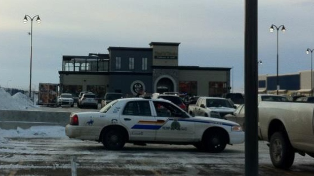 An RCMP vehicle parked near the Toad 'n' Turtle pub in Airdrie, Alta., is pictured on Jan. 12, 2013.
