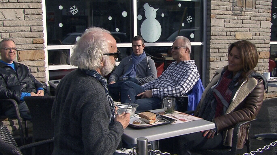 People sit out on the patio in Toronto on Saturday, Jan. 12, 2013.