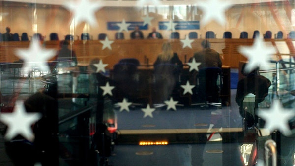 A view through a glass panel showing the European Court of Human Rights Thursday Dec. 16, 2010, in Strasbourg, eastern France. (AP / Christian Lutz)