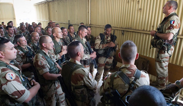 French soldiers of the 21st Marine Infantry Regiment listen during a briefing before boarding to Bamako, Mali, at the N'Djamena's airport, in Chad, Friday, Jan. 11, 2013. (R.Nicolas-Nelson, ECPAD)