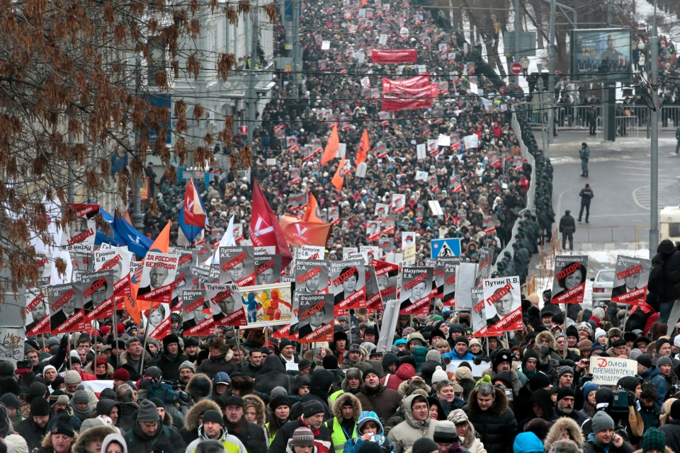People march during a protest rally in Moscow, Russia, Sunday, Jan. 13, 2013. (AP / Mikhail Metzel)