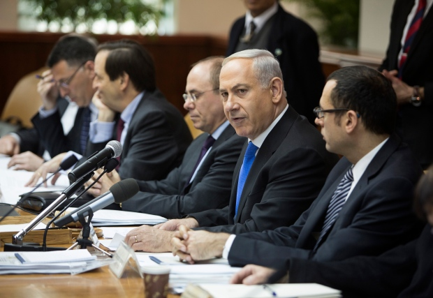 Netanyahu says he'll move ahead with settlements
