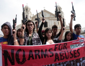 Students display toy guns to symbolize armed violence in the future if the government continue to neglect stronger gun control, in front of Quiapo church in Manila, Philippines, Friday, March 30, 2012. (AP / Pat Roque)