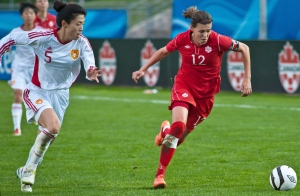 Canada's Christine Sinclair tries to out run China PR's Dongni Wang during a Women's International Friendly soccer match in Moncton, N.B. on Wednesday May 30, 2012. (Marc Grandmaison / THE CANADIAN PRESS)