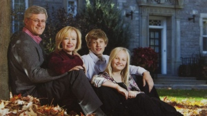 Prime Minister Stephen Harper, his wife Laureen Harper, son Ben and daughter Rachel are seen on the annual Christmas card taken outside the official residence of the prime minister, 24 Sussex Dr. in Ottawa. (THE CANADIAN PRESS/HO)
