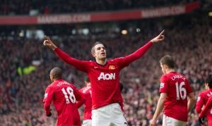 Manchester United's Robin van Persie celebrates after scoring against Liverpool during their English Premier League soccer match at Old Trafford Stadium, Manchester, England, Sunday Jan. 13, 2013. (AP / Jon Super)