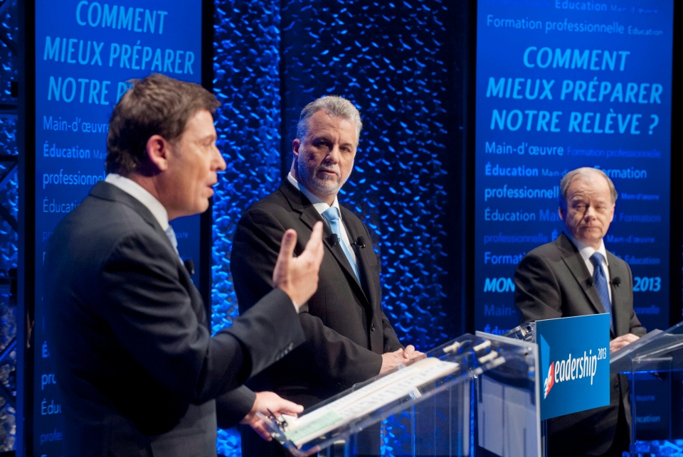 Pierre Moreau, left, speaks as Philippe Couillard, centre, and Raymond Bachand look on during the first PLQ leaders debate in Montreal, Sunday, January 13, 2013. THE CANADIAN PRESS/Graham Hughes