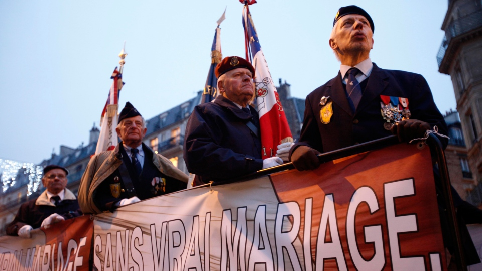 War veterans demonstrate with the fundamentalist Catholic group Civitas with a poster reading 'Without true marriage, no more, no more nation' in Paris, Sunday, Jan. 13, 2013. (AP / Michel Spingler)