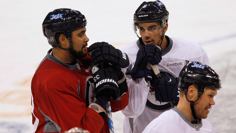 Winnipeg Jets' Dustin Byfuglien and Evander Kane talk on opening day of training camp in Winnipeg on Sunday, January 13, 2013. (John Woods / THE CANADIAN PRESS)
