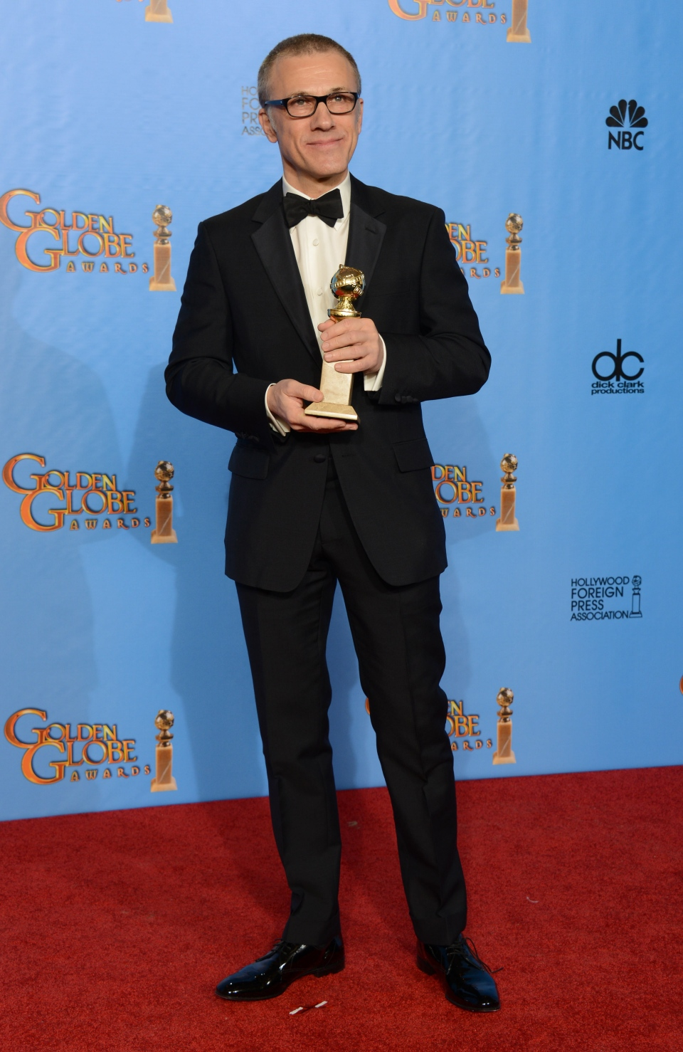 "Christoph Waltz poses with the award for best performance by an actor in a supporting role in a motion picture for ""Django Unchained"" backstage at the 70th Annual Golden Globe Awards at the Beverly Hilton Hotel in Beverly Hills, Calif., on Sunday Jan. 13, 2013. (Invision / Jordan Strauss)"