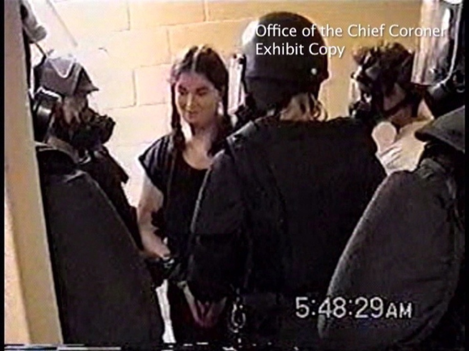 Ashley Smith is shown surrounded by guards at Joliette Institution in Joliette, Que., on July 26, 2007 in this image made from video. (THE CANADIAN PRESS/HO - Office of the Chief Coroner for Ontario)