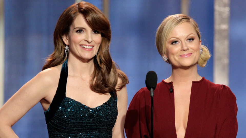 Hosts Tina Fey and Amy Poehler on stage during the 70th Annual Golden Globe Awards held at the Beverly Hilton Hotel on Sunday, Jan. 13, 2013, in Beverly Hills, Calif.