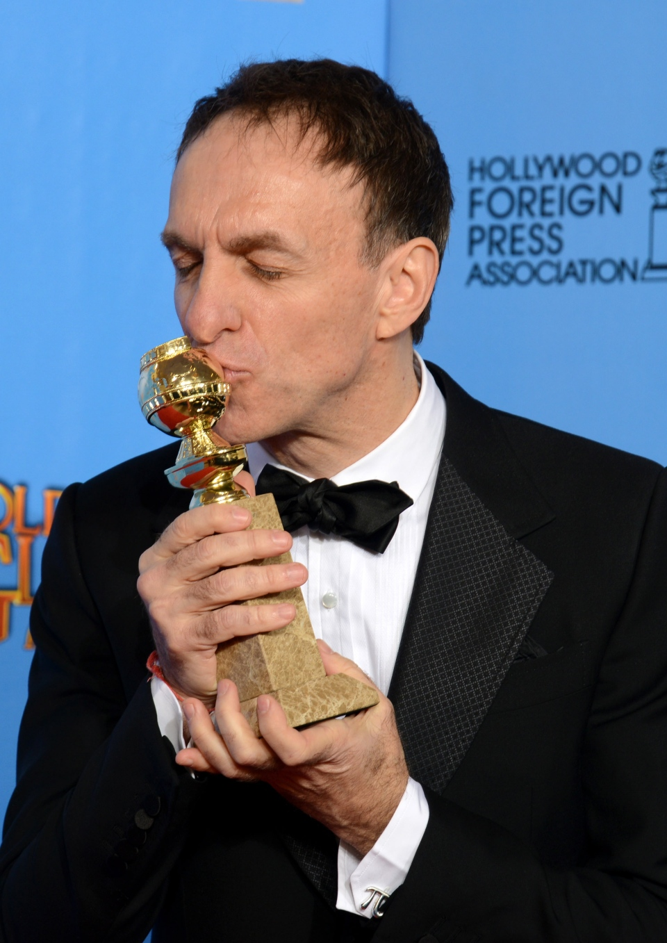 Mychael Danna poses with the award for best original score in a motion picture for 'Life of Pi' backstage at the 70th Annual Golden Globe Awards at the Beverly Hilton Hotel on Sunday, Jan. 13, 2013, in Beverly Hills, Calif. (Jordan Strauss / Invision)