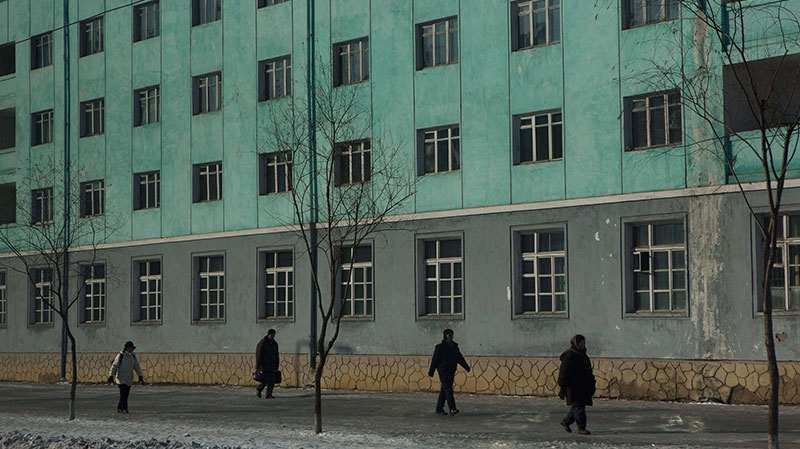 North Korean pedestrians walk along a sidewalk in Pyongyang, North Korea Thursday, Jan. 10, 2013. (AP / David Guttenfelder)