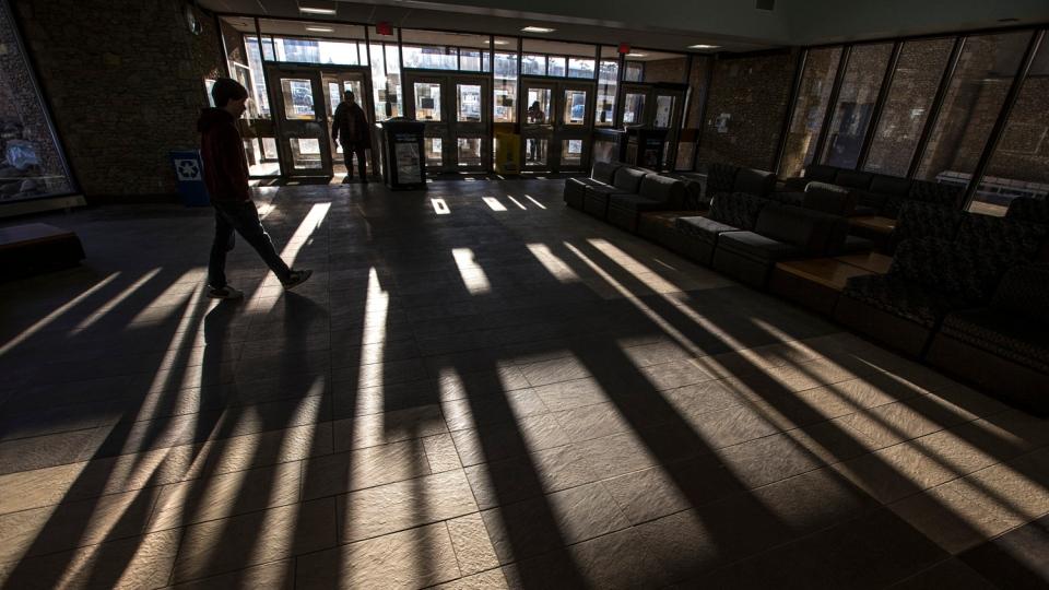A student walks inside the Place Riel building on the University of Saskatchewan campus.