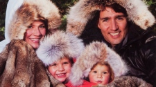 Liberal MP Justin Trudeau poses with his family on his annual Christmas card. THE CANADIAN PRESS/HO