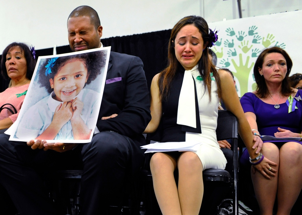 Jimmy Greene, foreground left, Nelba Marquez-Greene, center, parents of Sandy Hook Elementary School shooting victim Ana Marquez-Greene, and Nicole Hockley, right, mother of victim Dylan Hockley, react during a news conference at Edmond Town Hall in Newtown, Conn., Monday, Jan. 14, 2013. (AP Photo/Jessica Hill)