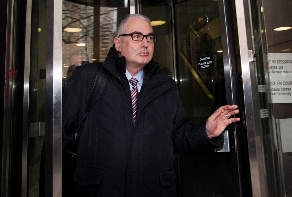 Former Nortel controller Michael Gollogly leaves a Toronto courthouse after he and two other top executives accused of defrauding the company were found not guilty on all charges on Monday, Jan. 14, 2013. (Michelle Siu / THE CANADIAN PRESS)