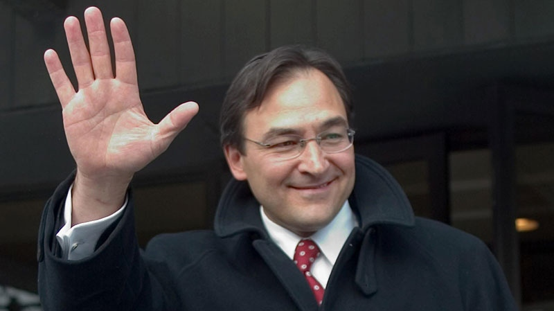 Former justice minister Martin Cauchon waves as he leaves a news conference announcing that he will not seek re-election in Montreal, Tuesday, Feb 3, 2004.. (Paul Chiasson / THE CANADIAN PRESS)