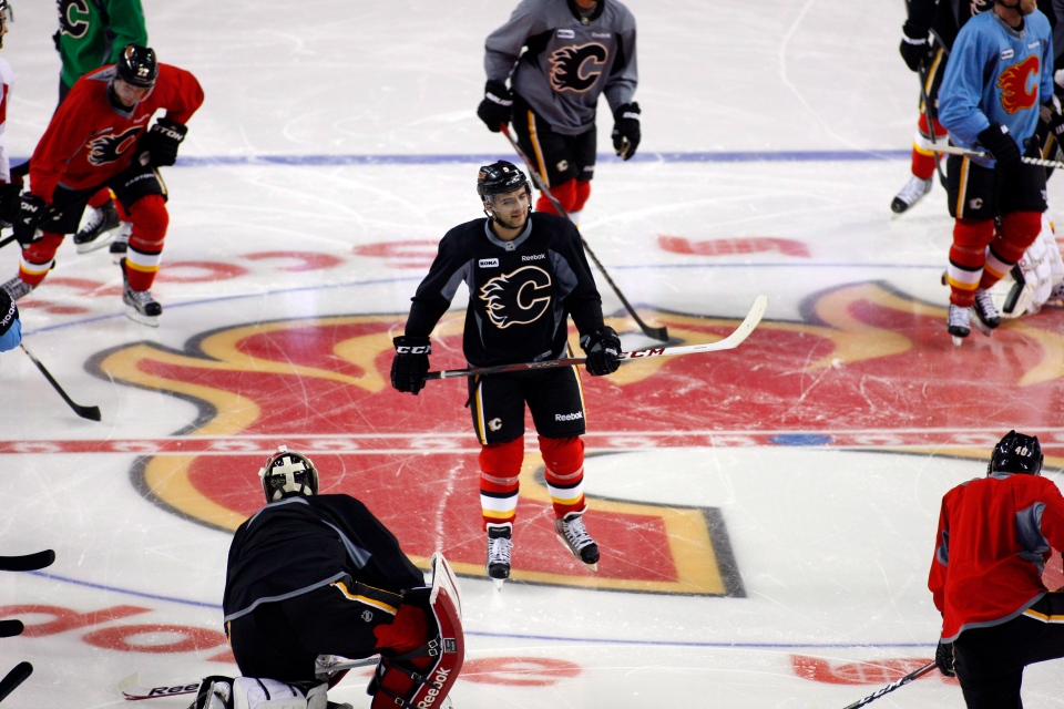 Calgary Flames skate during the first day of training camp in Calgary on Sunday, Jan. 13, 2013. (Jeff McIntosh/THE CANADIAN PRESS)