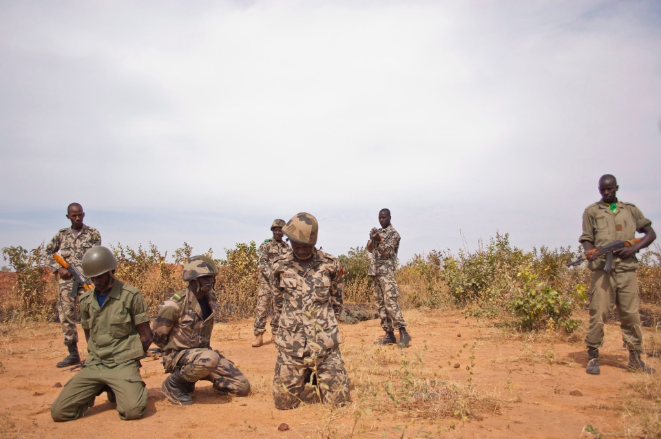 Soldiers from a Malian army special unit simulate a hostage-taking situation during a training exercise in the Barbe military zone, in Mopti, Mali, Nov. 24, 2012. (AP / Francois Rihouay)