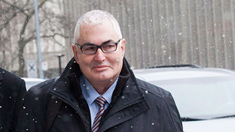 Former Nortel controller Michael Gollogly leaves a Toronto courthouse after he and two other top executives accused of defrauding the company were acquitted on all charges on Monday, January 14, 2013. (Michelle Siu / THE CANADIAN PRESS)