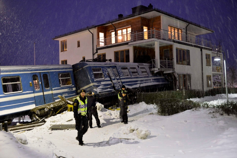 Emergency services attend the scene after a derailed train crashed into the side of a residential building in Saltsjobaden outside Stockholm, Tuesday Jan, 15, 2013.  (AP Photo/Jonas Ekströmer)