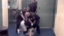 Stacy Bonds in Ottawa police custody is pictured in this frame grab from a video in 2008.