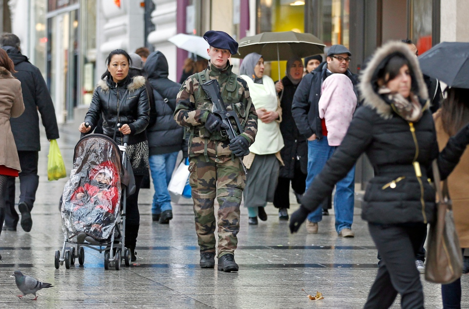 A French army soldier patrols down the Champs Elysee in Paris, Tuesday Jan. 15, 2013. (AP / Remy de la Mauviniere)