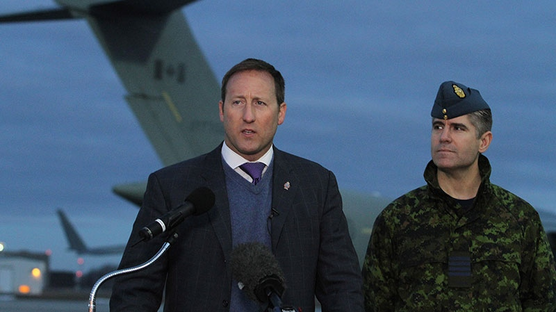 Minister of Defence Peter MacKay and CFB Trenton Commanding Officer Col. Sean Friday speaks during a press conference at CFB Trenton, in Trenton, Ont., on Tuesday Jan. 15, 2013. (Lars Hagberg / THE CANADIAN PRESS)
