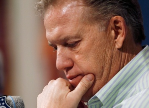 John Elway, the Denver Broncos executive vice president of football operations, considers questions about his team's loss to the Baltimore Ravens in an AFC Playof game, during a news conference at the team's headquarters in Englewood, Colo., on Monday, Jan. 14, 2013. (AP Photo/David Zalubowski)