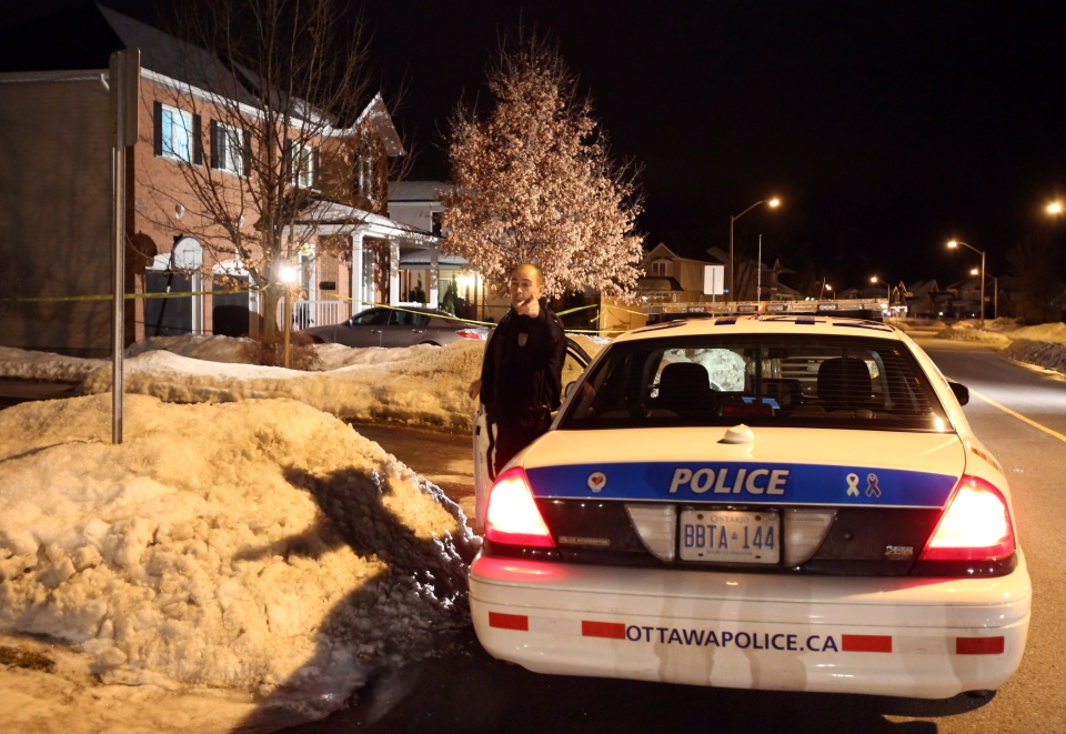 An Ottawa police car sits outside the scene of an investigation into three deaths in Stittsville, a suburb of Ottawa, on Monday, January 14, 2013. (Patrick Doyle / THE CANADIAN PRESS)