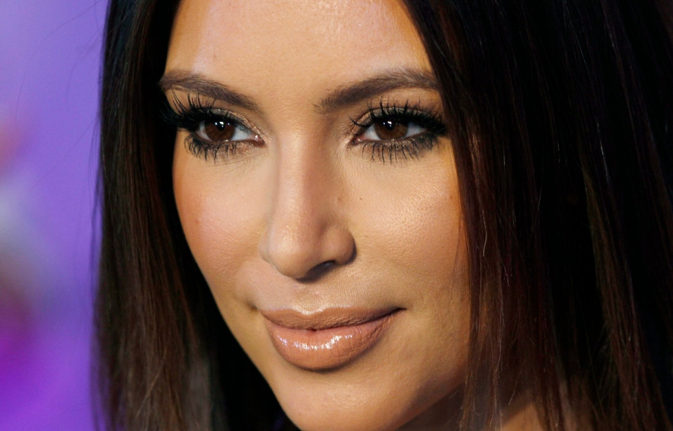 Television personality Kim Kardashian poses for photographers at the red carpet during the 40th anniversary of Cosmopolitan magazine in Spanish in Mexico City in this October 2012 file photo. (AP Photo/Marco Ugarte)
