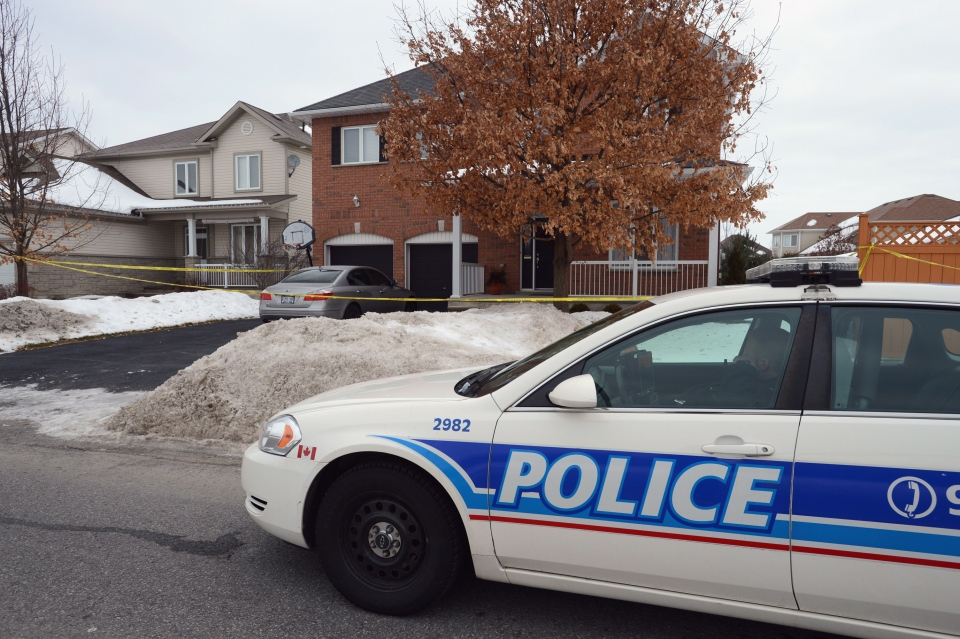 A police car sits in front of a house after after two children and an adult were found dead in Stitsville, Ont.,  on Tuesday, Jan. 15, 2013. (Sean Kilpatrick / THE CANADIAN PRESS)