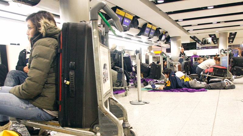 Passengers wait in Terminal 3 at Heathrow Airport in west London, Sunday, Dec. 19, 2010. (AP / Akira Suemori)
