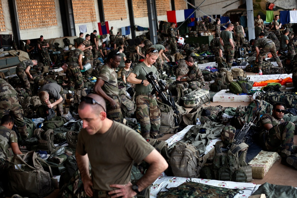 French troops gather in a hangar at Bamako's airport on Tuesday, Jan. 15, 2013. (AP / Jerome Delay)