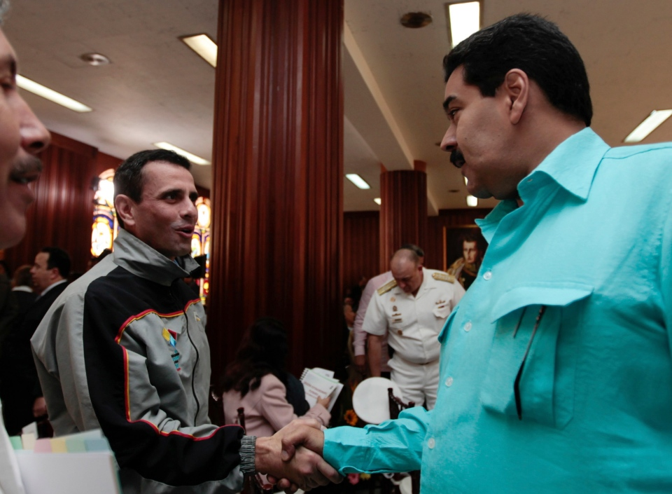 Venezuela's Vice President Nicolas Maduro, right, shakes hand with opposition leader, Miranda state Gov. Henrique Capriles during a meeting with the country's state governors, in Caracas, Venezuela, Tuesday, Jan. 15, 2013. (Miraflores Press Office)