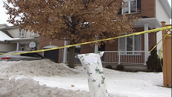Flowers were left outside a Stittsville home, the scene of a double murder/suicide.