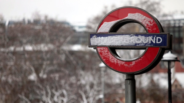 A sign of London's Underground transport system is seen covered in snow in central London, on Saturday, Dec. 18, 2010. (AP / Lefteris Pitarakis)