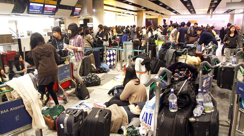 Passengers wait in Terminal 3 at Heathrow Airport in west London, Sunday, Dec. 19, 2010. (AP / Akira Suemori)