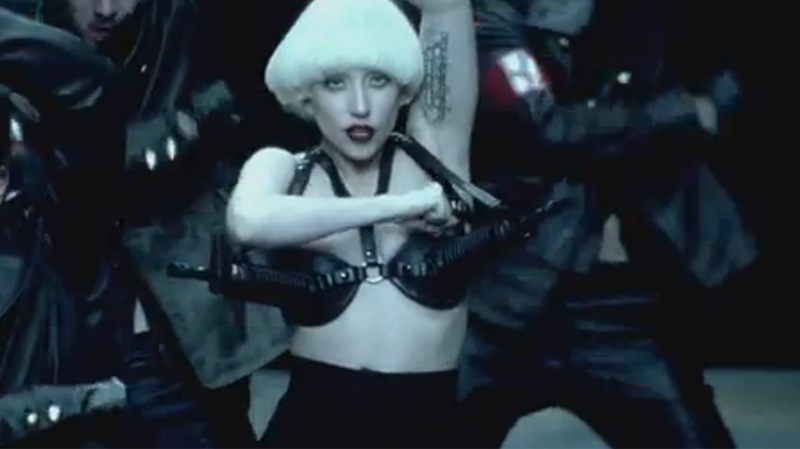 In this screen shot, pop star Lady Gaga is pictured wearing a 'gun bra' in her video for the single 'Alejandro.' (Photo courtesy YouTube)