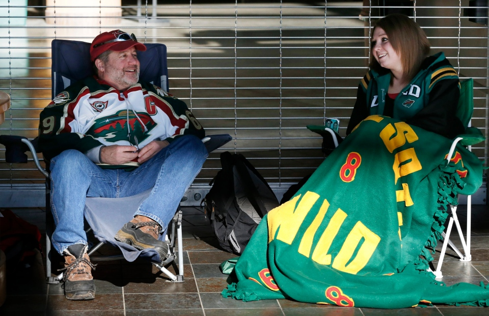 Minnesota Wild hockey fans Pat Vos, left, and Jess Crane marked their spots, first and second respectively, for Wild tickets at the Xcel Arena, Tuesday, Jan. 15, 2013. (AP / Jim Mone)