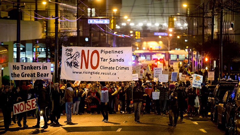 Protesters demonstrating against the Enbridge Northern Gateway Pipeline march through the streets in Vancouver, B.C., on Monday, Jan. 14, 2013. (Darryl Dyck / THE CANADIAN PRESS)