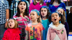 "Children from Newtown, Conn. and Sandy Hook Elementary school perform ""Somewhere Over the Rainbow"" on ABC's ""Good Morning America"" on Tuesday, Jan. 15, 2013 in New York. The Children who survived last month's shooting rampage, recorded a version of ""Over the Rainbow"" to raise money for charity. (Photo by Charles Sykes / Invision / AP)"