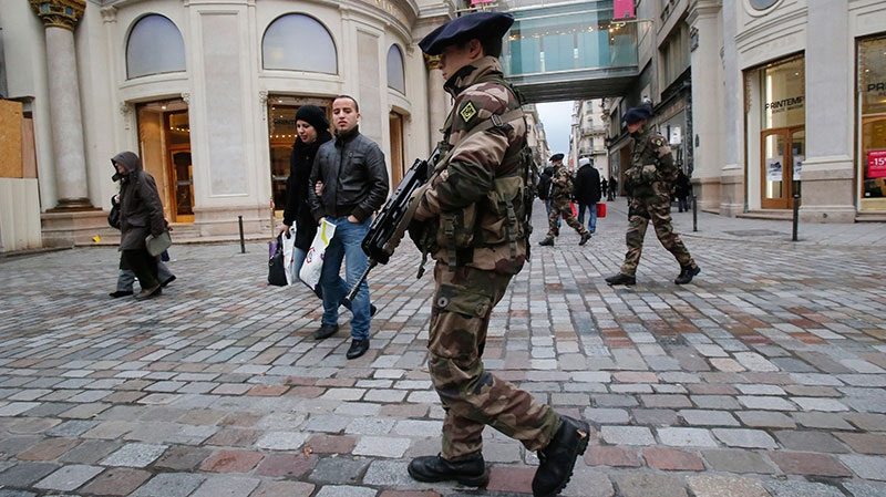 French army soldiers patrol along a main department store in Paris, Tuesday Jan. 15, 2013. (AP / Michel Euler)